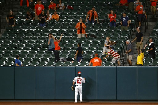 (AP Photo/Patrick Semansky). Baltimore Orioles left fielder DJ Stewart watches as spectators scramble for a three-run home run ball that was hit by Oakland Athletics' Matt Olson in the third inning of a baseball game, Wednesday, Sept. 12, 2018, in Balt...