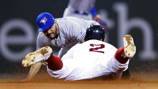 (AP Photo/Charles Krupa). Toronto Blue Jays second baseman Devon Travis, right, tags out Boston Red Sox's Xander Bogaerts, who tried to advance to second on his single, during the fourth inning of a baseball game at Fenway Park in Boston, Wednesday, Se...