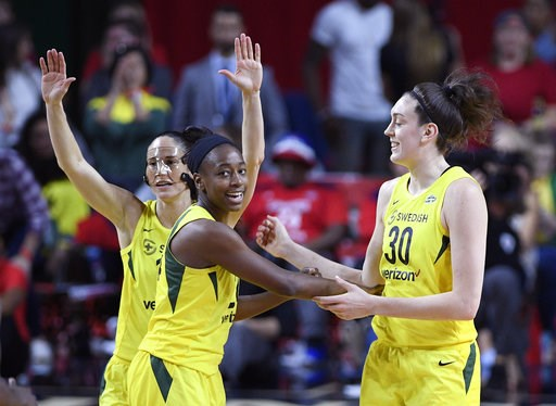 (AP Photo/Nick Wass). Seattle Storm guard Sue Bird, back left, Jewell Loyd, center, and Breanna Stewart (30) react during the first half of Game 3 of the WNBA basketball finals against the Washington Mystics, Wednesday, Sept. 12, 2018, in Fairfax, Va.