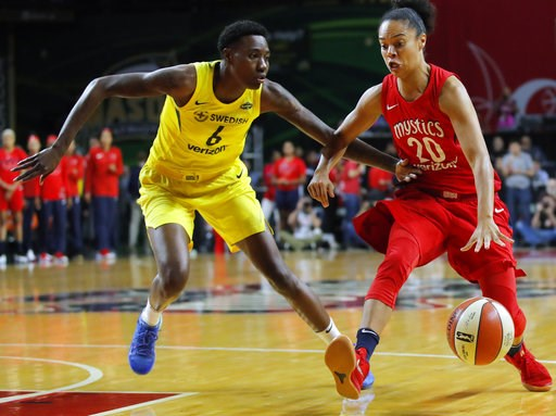 (AP Photo/Carolyn Kaster). Seattle Storm forward Natasha Howard (6) defends as Washington Mystics guard Kristi Toliver (20) drives to the basket during the first half of Game 3 of the WNBA basketball finals, Wednesday, Sept. 18 2018, in Fairfax, Va.