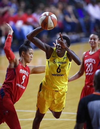 (AP Photo/Nick Wass). Seattle Storm forward Natasha Howard (6) goes to the basket against Washington Mystics guard Natasha Cloud (9) during the first half of Game 3 of the WNBA basketball finals, Wednesday, Sept. 12, 2018, in Fairfax, Va. Cloud was cha...