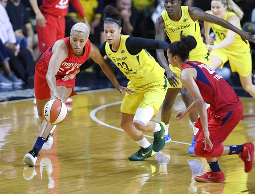 (AP Photo/Nick Wass). Washington Mystics forward Tianna Hawkins (21) battles for the ball against Seattle Storm forward Alysha Clark (32) during the first half of Game 3 of the WNBA basketball finals, Wednesday, Sept. 12, 2018, in Fairfax, Va. Also see...