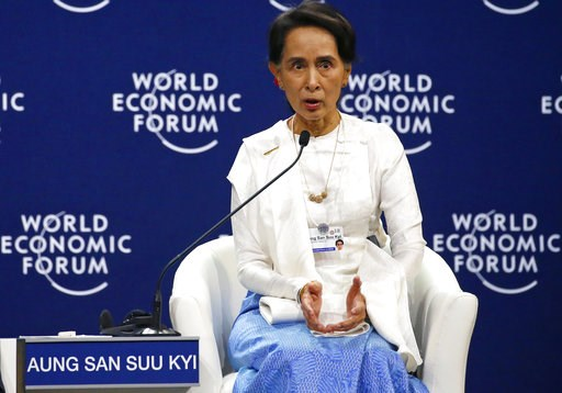 (AP Photo/Bullit Marquez). Aung San Suu Kyi, the State Counsellor of Myanmar, gestures during a one-on-one discussion at the World Economic Forum's meeting at the National Convention Center Thursday, Sept. 13, 2018 in Hanoi, Vietnam. Suu Kyi says the c...