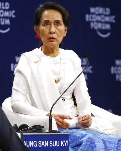 (AP Photo/Bullit Marquez). Aung San Suu Kyi, the State Counsellor of Myanmar, gestures during a one-on-one discussion at the World Economic Forum's meeting at the National Convention Center Thursday, Sept. 13, 2018 in Hanoi, Vietnam. Suu Kyi said the c...