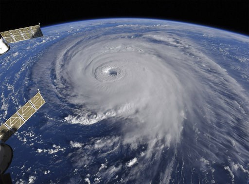 (NASA via AP). This image provided by NASA shows Hurricane Florence from the International Space Station on Wednesday, Sept. 12, 2018, as it threatens the U.S. East Coast. Hurricane Florence is coming closer and getting stronger on a path to squat over...