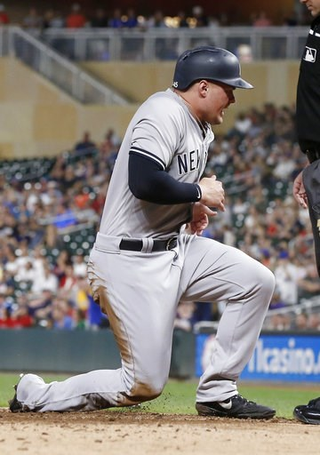 (AP Photo/Jim Mone). New York Yankees' Luke Voit celebrates as he scores the Yankees only run after Greg Bird broke up Minnesota Twins pitcher Jake Odorizz's no-hit bid with a double in the eighth inning of a baseball game Wednesday, Sept. 12, 2018, in...
