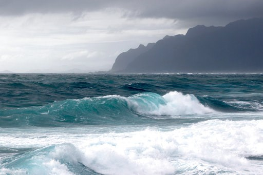 (AP Photo/Caleb Jones). Waves break as Tropical Storm Olivia approaches Oahu, Wednesday, Sept. 12, 2018 in Laie, Hawaii.