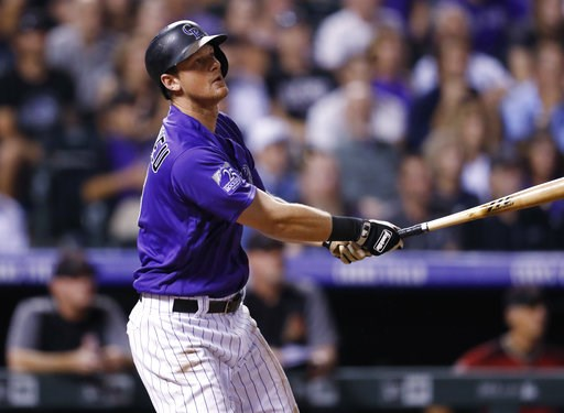 (AP Photo/David Zalubowski). Colorado Rockies' DJ LeMahieu follows the flight of his two-run, walkoff home run off Arizona Diamondbacks relief pitcher Yoshihisa Hirano in the ninth inning of a baseball game Wednesday, Sept. 12, 2018, in Denver. The Roc...