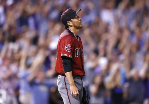 (AP Photo/David Zalubowski). Arizona Diamondbacks relief pitcher Yoshihisa Hirano reacts after giving up a two-run, walkoff home run to Colorado Rockies' DJ LeMahieu in the ninth inning of a baseball game Wednesday, Sept. 12, 2018, in Denver. The Rocki...