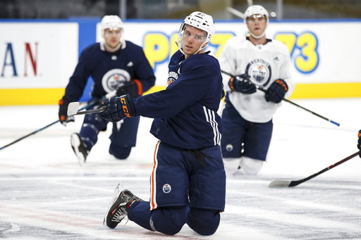 (Codie McLachlan/The Canadian Press via AP, File). FILE - In this Sept. 15, 2017, file photo, Edmonton Oilers captain Connor McDavid warms up during NHL hockey training camp at Rogers Place in Edmonton, Alberta. The Oilers _ who have the selling point ...