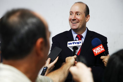 (AP Photo/Jacquelyn Martin, File). FILE - In this July 3, 2018, file photo, Washington Capitals NHL hockey new head coach Todd Reirden answers questions from members of the media after a news conference in Arlington, Va. The celebrating is over for now...