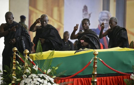 (AP Photo/Sunday Alamba). Members of the public pay their respects as the coffin of former U.N. Secretary-General Kofi Annan, draped in the Ghana flag, lies in state at the Accra International Conference Center in Ghana Wednesday, Sept. 12, 2018. Ghana...