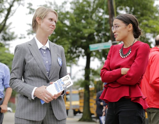 (AP Photo/Seth Wenig). New York democratic gubernatorial candidate Cynthia Nixon, left, and congressional candidate Alexandria Ocasio-Cortez talk while campaigning in New York, Wednesday, Sept. 12, 2018.  Democratic primary voters in New York on Thursd...