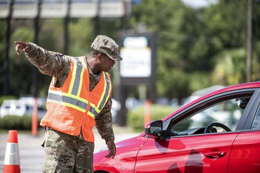 (AP Photo/Sean Rayford). A National Guardsman directs traffic onto U.S. Highway 501 as Hurricane Florence approaches the East Coast Wednesday, Sept. 12, 2018, near Conway, S.C. Time is running short to get out of the way of Hurricane Florence, a monste...
