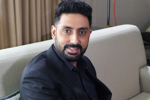 """(AP Photo/John Carucci). This Sept. 11, 2018 photo shows Bollywood actor Abhishek Bachchan during the Toronto Film Festival in Toronto, Canada. Bachchan is cheering India's decision to strike down a ban on consensual gay sex, calling it """"a wonderful st..."""