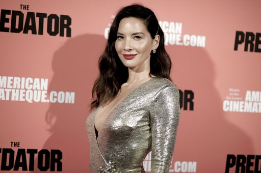 """(Photo by Richard Shotwell/Invision/AP). Olivia Munn attends a special screening of """"The Predator"""" at Grauman's Egyptian Theatre on Wednesday, Sept. 12, 2018, in Los Angeles."""