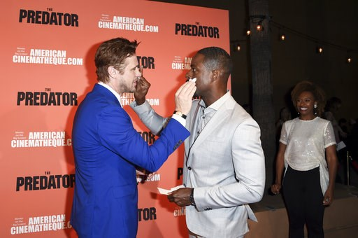 """(Photo by Richard Shotwell/Invision/AP). Boyd Holbrook, from left, Sterling K. Brown and Ryan Michelle Bathe attend a special screening of """"The Predator"""" at Grauman's Egyptian Theatre on Wednesday, Sept. 12, 2018, in Los Angeles."""
