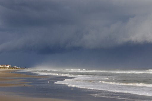 (AP Photo/Tom Copeland). A storm front is seen on the beach in North Topsail Beach, N.C., prior to Hurricane Florence moving toward the east coast on Wednesday, Sept. 12, 2018. Hurricane Florence is putting a corridor of more than 10 million people in ...
