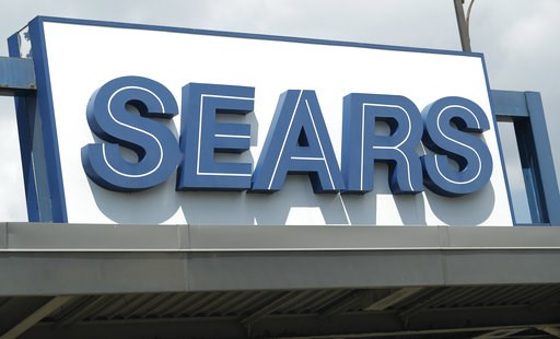 (AP Photo/David Zalubowski). In this Saturday, July 21, 2018, photo the outdoor sign stands in the parking lot of a Sears department store in Saint Paul, Minn. Sears Holdings Corp. reports earns Thursday, Sept. 13.