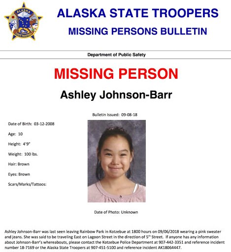 (Alaska State Troopers via AP). This missing person poster released by Alaska State Troopers shows Ashley Johnson-Barr, who was last seen leaving Rainbow Park in Kotzebue, Alaska, on Sept. 6, 2018, wearing a pink sweater and jeans. A search that includ...