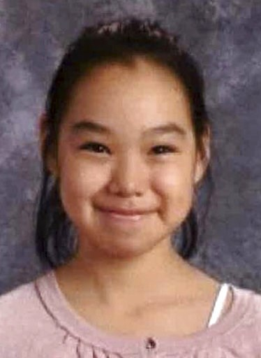 (Alaska State Troopers via AP). This undated photo that is part of a missing person poster released by Alaska State Troopers shows Ashley Johnson-Barr, who was last seen leaving Rainbow Park in Kotzebue, Alaska, on Sept. 6, 2018, wearing a pink sweater...