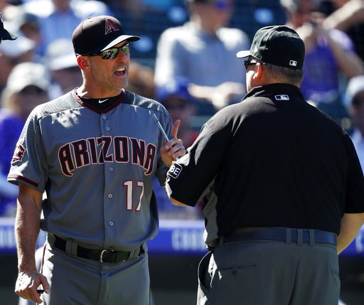 (AP Photo/David Zalubowski). Arizona Diamondbacks manager Torey Lovullo, left, argues with second base umpire Fieldin Culbreth over a call while facing the Colorado Rockies in the fifth inning of a baseball game Thursday, Sept. 13, 2018, in Denver.