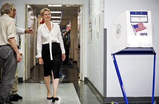 (AP Photo/Bebeto Matthews). Polling station officials direct New York gubernatorial candidate Cynthia Nixon to her voting area for the primary, Thursday, Sept. 13, 2018, in New York. Democrats across New York state are picking the winner of a long and ...