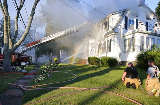 (AP Photo/Mary Schwalm). Firefighters battle a house fire, Thursday, Sept. 13, 2018, on Herrick Road in North Andover, Mass., one of multiple emergency crews responding to a series of gas explosions and fires triggered by a problem with a gas line that...