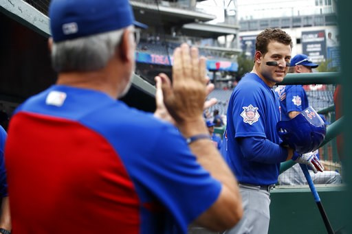 (AP Photo/Jacquelyn Martin). Chicago Cubs first baseman Anthony Rizzo (44) looks at manager Joe Maddon, left, as Maddon claps for the team at the start of a baseball game against the Washington Nationals, Thursday, Sept. 13, 2018, at Nationals Park in ...