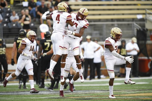 (AP Photo/Woody Marshall). Boston College's Hamp Cheevers (4) and Brandon Sebastian (10) celebrate Cheevers' interception during the first half of an NCAA college football game against Wake Forest, Thursday, Sept. 13, 2018, in Winston-Salem, N.C.