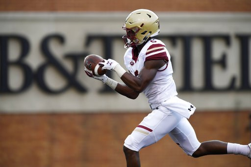(AP Photo/Woody Marshall). Boston College's Jeff Smith (6) makes a touchdown reception during the first half of an NCAA college football game against Wake Forest, Thursday, Sept. 13, 2018, in Winston-Salem, N.C.