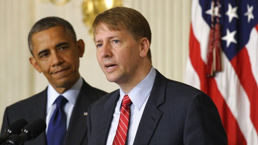 (AP Photo/Susan Walsh, File). FILE - In this July 17, 2013 file photo, President Barack Obama, left, listens as Richard Cordray, right, the new director of the Consumer Financial Protection Bureau, speaks in the State Dining Room of the White House in ...