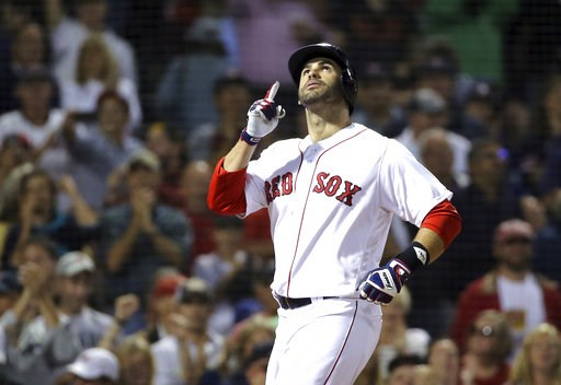 (AP Photo/Elise Amendola). Boston Red Sox's J.D. Martinez celebrates his solo home run as he crosses the plate in the second inning of a baseball game against the Toronto Blue Jays at Fenway Park, Thursday, Sept. 13, 2018, in Boston.