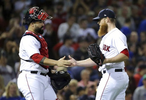 (AP Photo/Elise Amendola). Boston Red Sox closer Craig Kimbrel celebrates with catcher Sandy Leon after they defeated the Toronto Blue Jays in a baseball game at Fenway Park, Thursday, Sept. 13, 2018, in Boston.