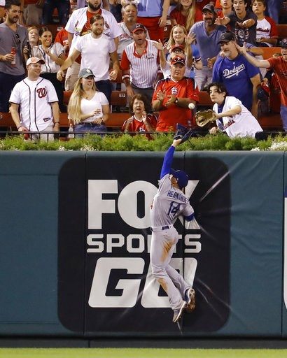 (AP Photo/Billy Hurst). Los Angeles Dodgers center fielder Enrique Hernandez cannot catch a home run hit by St. Louis Cardinals' Tyson Ross during the fifth inning of a baseball game Thursday, Sept. 13, 2018, in St. Louis.
