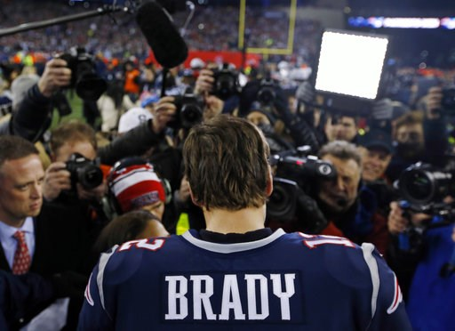 (AP Photo/Winslow Townson, File). FILE - In this Jan. 21, 2018, file photo, New England Patriots quarterback Tom Brady talks with a reporter after the AFC Championship NFL football game against the Jacksonville Jaguars at Gillette Stadium in Foxborough...