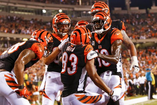(AP Photo/Frank Victores). Cincinnati Bengals wide receiver Tyler Boyd (83) celebrates with wide receiver A.J. Green (18) and his teammates after scoring a touchdown in the first half of an NFL football game against the Baltimore Ravens, Thursday, Sept...