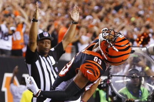 (AP Photo/Frank Victores). Cincinnati Bengals wide receiver Tyler Boyd (83) celebrates after scoring a touchdown in the first half of an NFL football game against the Baltimore Ravens, Thursday, Sept. 13, 2018, in Cincinnati.