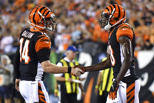 (AP Photo/Bryan Woolston). Cincinnati Bengals wide receiver A.J. Green, right, celebrates with quarterback Andy Dalton (14) after scoring a touchdown in the first half of an NFL football game, Thursday, Sept. 13, 2018, in Cincinnati.