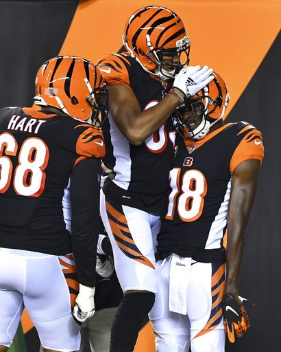 (AP Photo/Bryan Woolston). Cincinnati Bengals wide receiver A.J. Green (18) celebrates his touchdown in the first half of an NFL football game against the Baltimore Ravens, Thursday, Sept. 13, 2018, in Cincinnati.