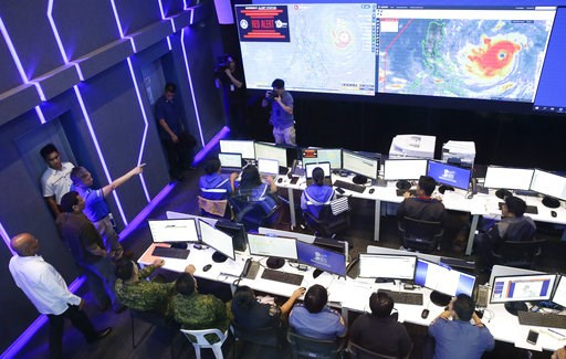 (AP Photo/Aaron Favila). Philippine President Rodrigo Duterte, second from left, observes the National Disaster Risk Reduction and Management Council operation center in metropolitan Manila, Philippines on Thursday, Sept. 13, 2018. The Philippine offic...