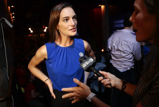 (AP Photo/Julie Jacobson). Julia Salazar, left, answers questions during an interview after winning the Democratic primary over Martin Dilan in New York's 18th State Senate district race, Thursday, Sept. 13, 2018, in New York.