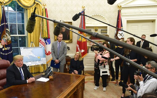(AP Photo/Susan Walsh). President Donald Trump, left, joined by FEMA Administrator Brock Long, second from left, and Homeland Security Secretary Kirstjen Nielsen, center, speaks during a briefing on Hurricane Florence in the Oval Office of the White Ho...