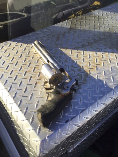 (Kern County Sheriff's Office via AP). This photo provided the Kern County Sheriff's Office shows the .50-caliber handgun allegedly used by Javier Casarez to kill five people and then himself after being confronted by a deputy Wednesday, Sept. 12, 2018...