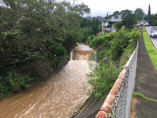 (AP Photo/Caleb Jones). Water is seen rushing through a spillway in a neighborhood below the Nuuanu Dam in Honolulu on Thursday, Sept. 13, 2018. Honolulu officials say they may need to evacuate 10,000 people from a residential neighborhood if water in ...