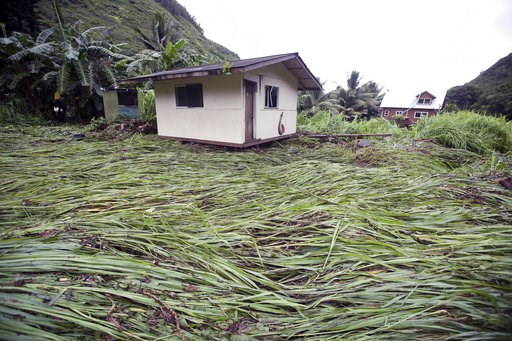 (Chris Sugidono/The News via AP). A bedroom building sits atop downed vegetation after being swept up by floodwaters Wednesday, Sept. 12, 2018, in Maui's Honokohau Valley in Hawaii. Honolulu officials are preparing for the possible evacuation of 10,000...