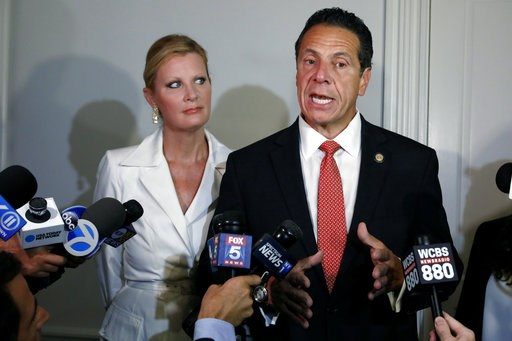 (AP Photo/Richard Drew). New York Gov. Andrew Cuomo is accompanied by his girlfriend Sandra Lee as he talks to the press after casting his primary election ballot, at the Presbyterian Church of Mount Kisco, in Mount Kisco, N.Y., Thursday, Sept. 13, 2018.