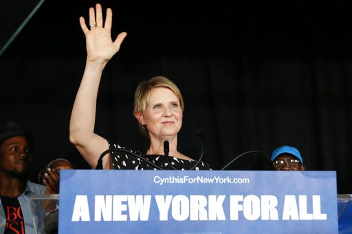 (AP Photo/Jason DeCrow). Gubernatorial candidate Cynthia Nixon arrives to deliver her concession speech at the Working Families Party primary night party,Thursday, Sept. 13, 2018, in New York.