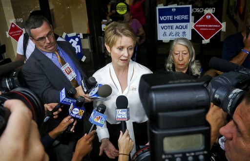 (AP Photo/Bebeto Matthews). New York gubernatorial candidate Cynthia Nixon, center, speaks to members of the media outside a polling station after voting in the primary, Thursday, Sept. 13, 2018, in New York. Democrats across New York state are picking...