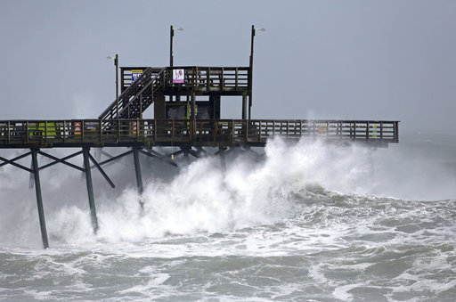 (AP Photo/Tom Copeland). Waves from Hurricane Florence pound the Bogue Inlet Pier in Emerald Isle N.C., Thursday, Sept. 13, 2018.